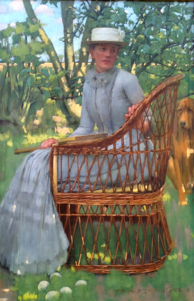Edwardian woman in wicker chair