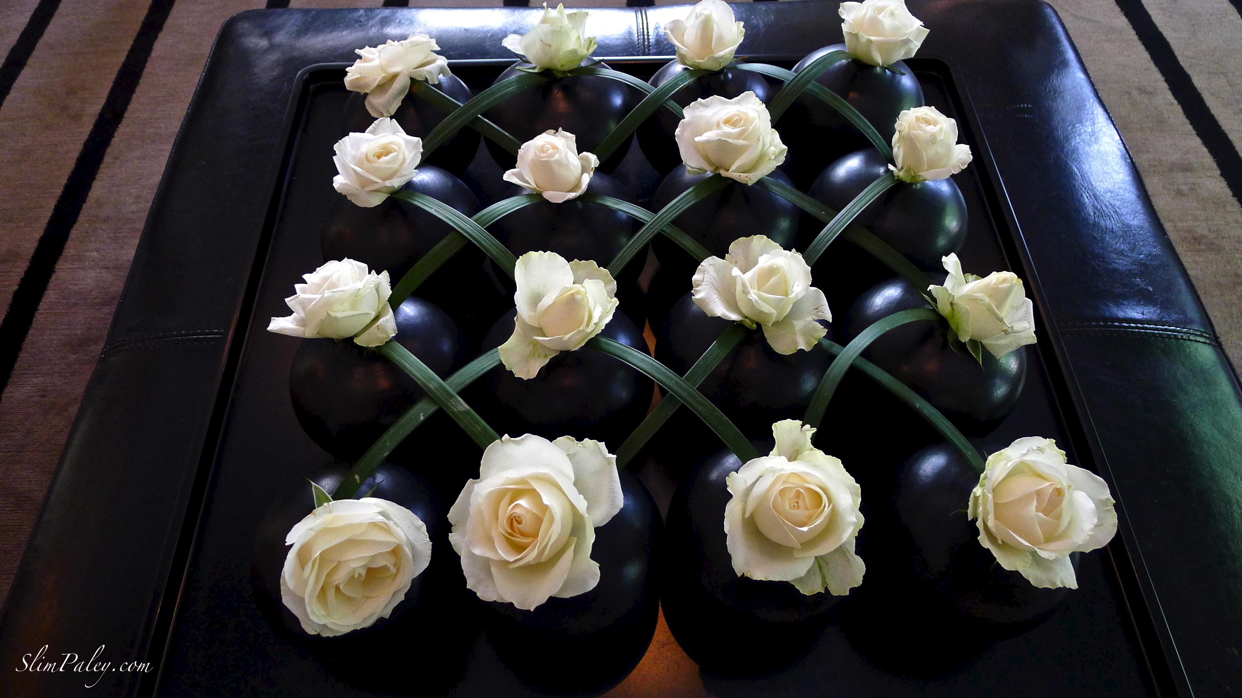 white roses in black vases, Slim Paley photo, Sri Lanka